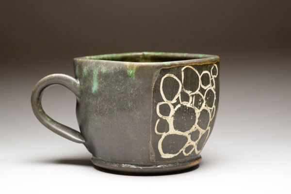 Ceramic cup on gradated background