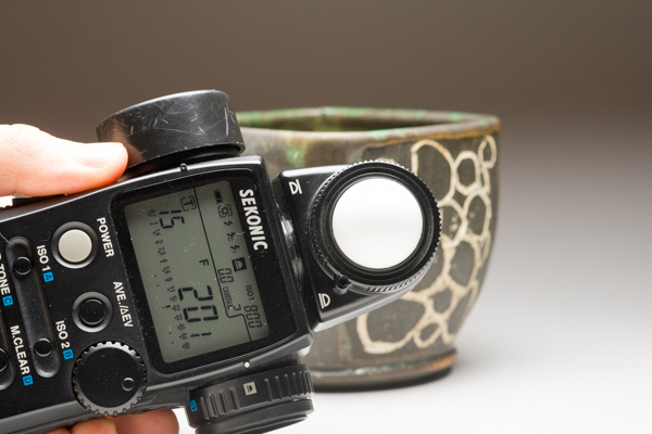 Checking exposure levels on a light meter