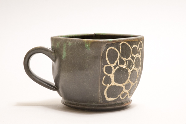 A ceramic mug casting a soft shadow below it