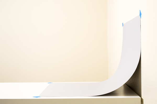 Side view of paper formed into an arc to create a sweep