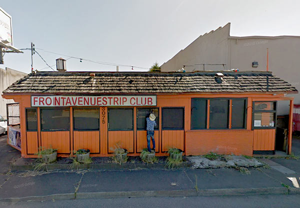 A man peeks in to a strip club in this image from Google Street View