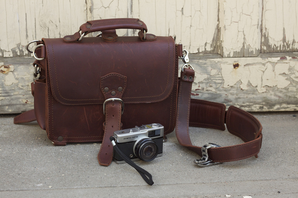 Leather satchel and rangefinder camera