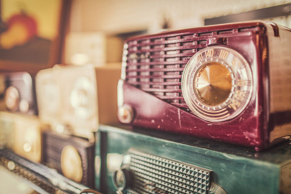 Warm photograph of a collection of old radios