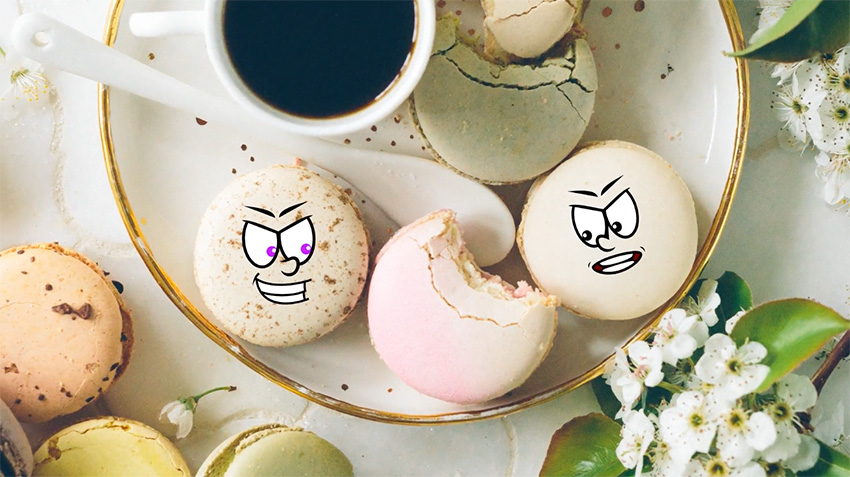 Cartoon faces superimposed on meringues
