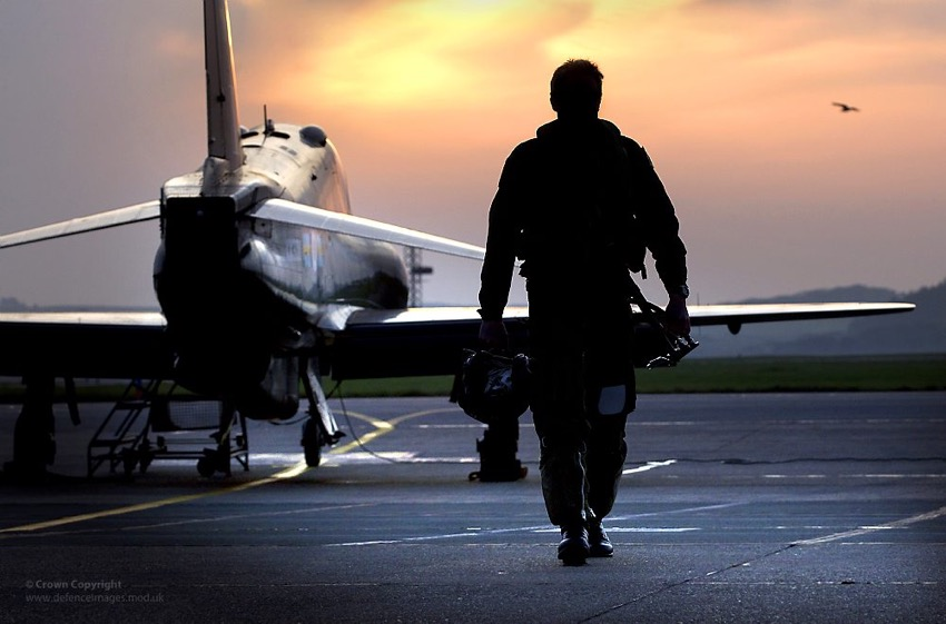 RAF Pilot Walking Away from Hawk Aircraft in Silhouette