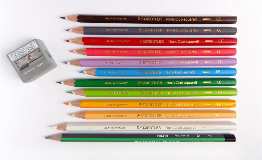 Colored pencils a graphite pencil and a sharpener